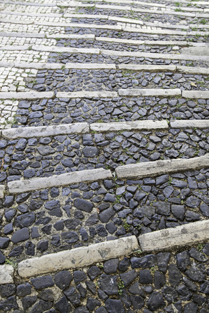 Lisbon typical stairs, detail of a cobblestone floor