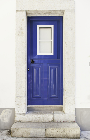 Old decorated door in blue, detail of urban decoration, protection