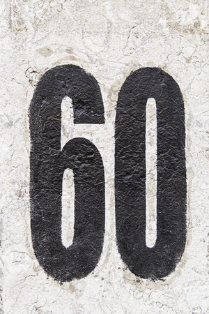Number sixty painted detail of an even number of information, anniversary Stock Photo