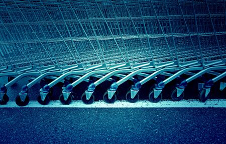 Shopping carts in a supermarket, detail of metal carts in a supermarket, order to make the purchase
