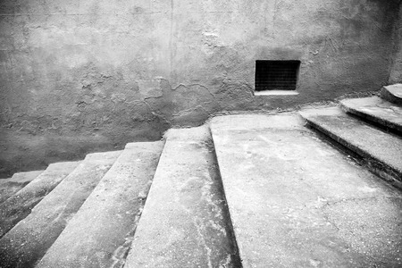 frequented: Staircase with window detail of old stone stairs, textured background, ancient architecture