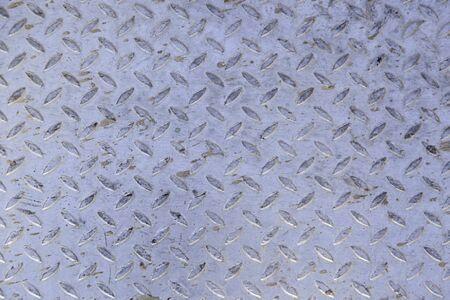 diamond plate: Rough metal background, detail of a non-slip metal, textured background, dirty and damaged metal
