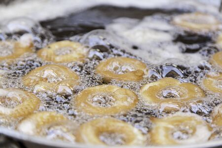 Fried donuts, detail of a traditional market, homemade confectionery