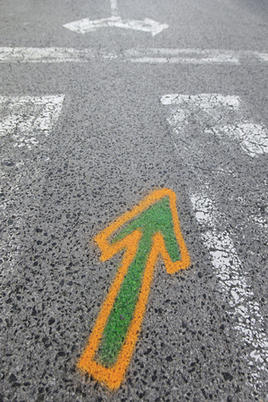 Arrow painted on the asphalt, detail of information and indication, road safety Stock Photo
