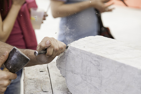 Carving stone, craftsman shaping stone, art and crafts Stock Photo