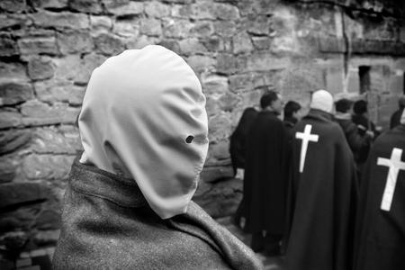 flogging: SAN VICENTE DE LA SONSIERRA, SPAIN - GOOD FRIDAY FRIDAY APRIL 6: Man does penance through self-flagellation during Easter holy procession on April 6, 2012, San Vicente de la Sonsierra, Spain.