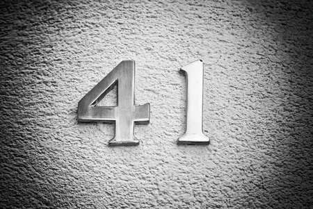 Number forty-one on the wall of a house, detail of an odd number