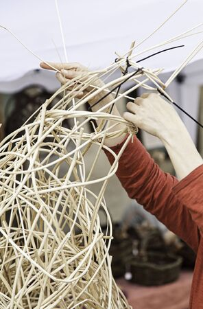 interleaved: Manufacturing, wicker, detail of a manual and artisanal work, art and craft