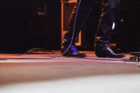 Feet of a singer at a concert, detail of a rock concert, party and music Stock Photo