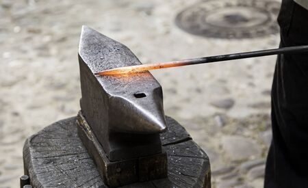 Red hot iron in a forge, working with hot iron, traditional work