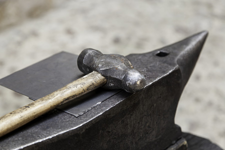 Old hammer and anvil on a forge, detail of old tool Stock Photo
