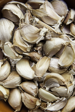 flavouring: Detail of dried garlic in a market, food and condiment Stock Photo