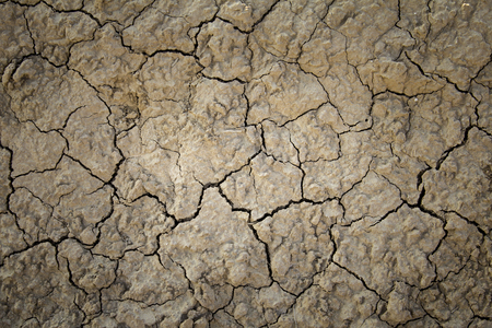 Dry mud soil by drought, detail of climate change, desert and natural disaster