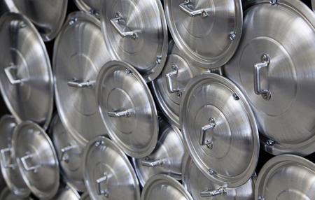 saute: Metal covers for pots and pans, kitchen utensils detail