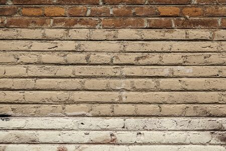 solid background: Old broken wall made of mud bricks, textured background detail, neglect and ruin Stock Photo
