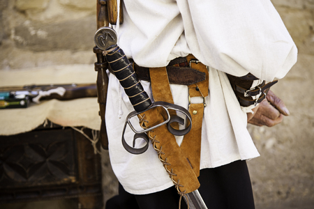 Ancient sword in a knight of medieval warfare, detail of weapon and death Stock Photo