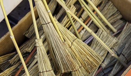 white wood floor: Detail of brooms for witches in halloween, detail of decoration and superstition, magic and mystery