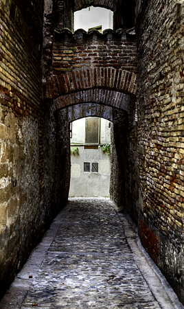 Old medieval alley in an old town, detail of historic architecture Stock Photo