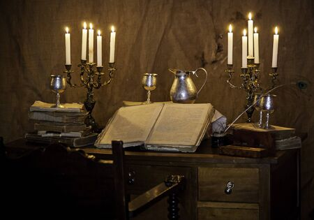 Old medieval desk with pen and book, detail of place to read and write Stock Photo