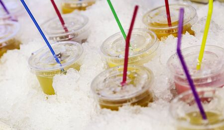 Cold natural fruit juices in a market, detail of healthy drink, vitamins Stock Photo