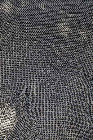 Old mesh quota of medieval armor, detail of protection and security