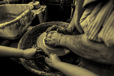 Person working with clay, detail of craftsmanship, craftsmanship in clay, potter