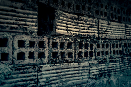 Old broken wall made of mud bricks, textured background detail, neglect and ruin Stock Photo