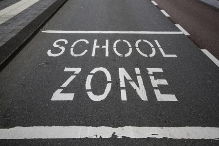 School sign on the asphalt, information traffic sign
