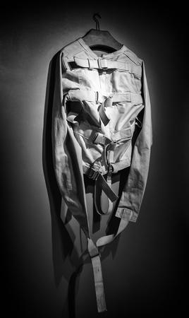 Old psychiatric straitjacket, mental hospital detail, psychosis Archivio Fotografico