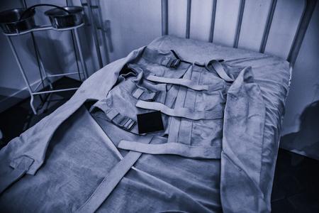 Old psychiatric straitjacket, mental hospital detail, psychosis Imagens