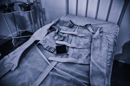Old psychiatric straitjacket, mental hospital detail, psychosis Stock Photo