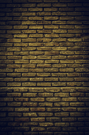 Fund damaged brick wall, detail of old bricks in the city, textured background Archivio Fotografico