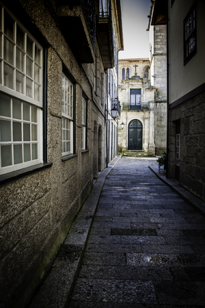 Old alley in the city, detail of an old street in a town in Spain Editorial