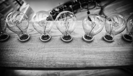 Lighted bulbs, detail of a light bulb to illuminate and give light, electricity Standard-Bild - 120894431