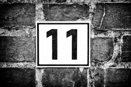 Number eleven, detail of odd number in a house, postal address Standard-Bild