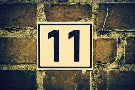 Number eleven, detail of odd number in a house, postal address
