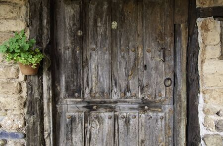Old closed wooden window, construction and architecture