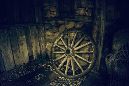 Old wooden carriage wheel, antique detail, transport