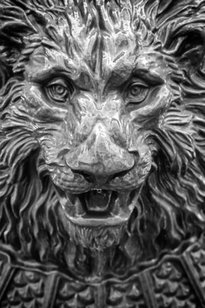 Lion head fountain, detail of a lion-shaped fountain, street art, monument