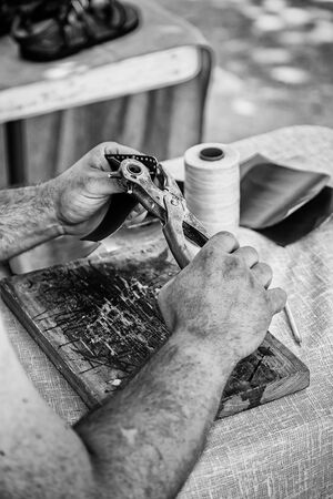 Man working with leather, detail of a person working with your hands