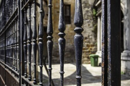 Old metal wrought iron fence, security and protection detail