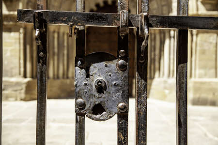 Ancient medieval lock, security detail and metal decoration, history