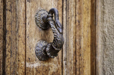 Old rusty door knocker, decoration and communication detail, vintage Фото со стока