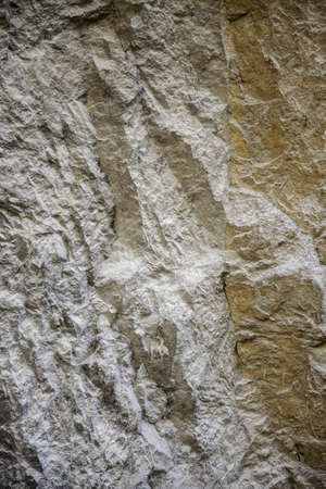 Stone texture in the mountain, detail of natural stone, rough and extreme Фото со стока