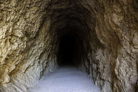 Deep stone tunnel, detail of ancient cave on a mountain