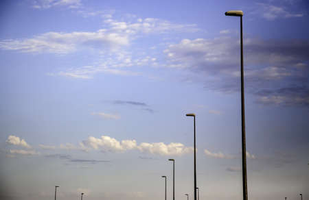 Lampposts with sky background, detail of lighting in the city Фото со стока