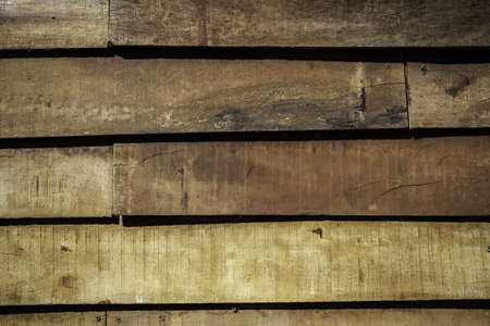 Weathered and abandoned brown wood, wooden background detail, passage of time