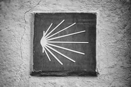 Shell of the Camino de Santiago, sign for pilgrims, international tradition Фото со стока
