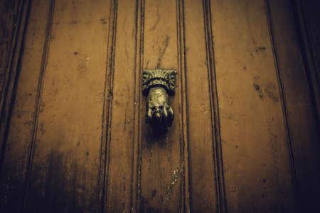 Antique bronze door knocker, decoration detail, vintage