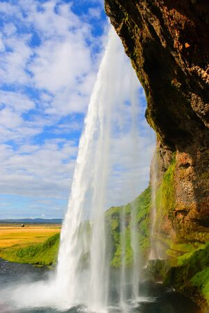 rear view of the waterfall Seljalandfoss 版權商用圖片 - 8929761